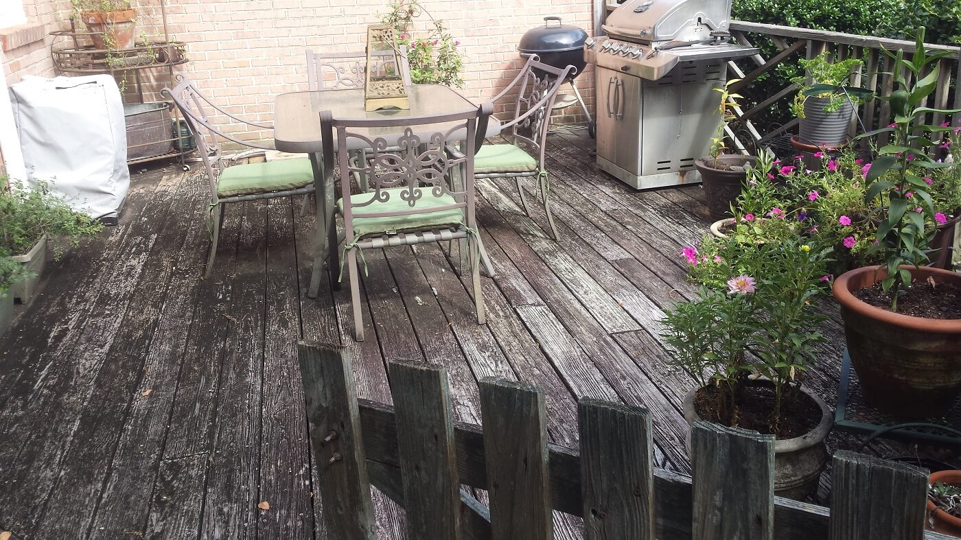 Old deck with dining area and outdoor kitchen