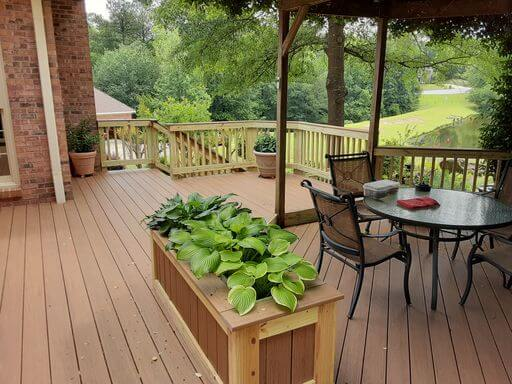Custom deck with planter box and seating area