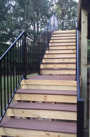 Deck staircase with iron railing