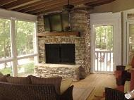 enclosed porch with built in fireplace