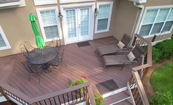 deck with lounge chairs and table
