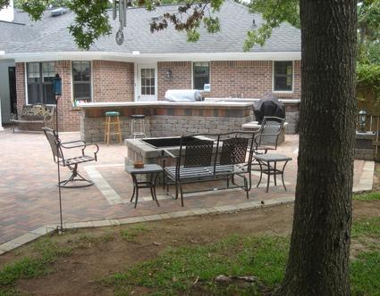 Outdoor kitchen patio and seating area