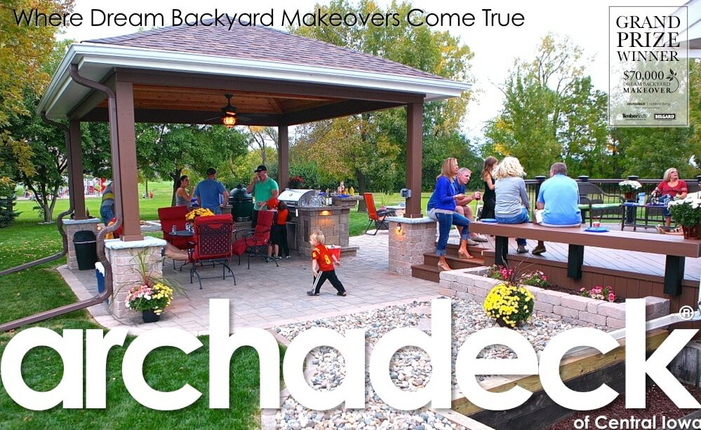 Deck and patio with outdoor kitchen with families and friends gathered