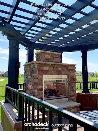 Custom outdoor space with pergola and outdoor fireplace