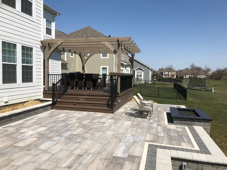 Custom patio and deck with pergola and fire pit