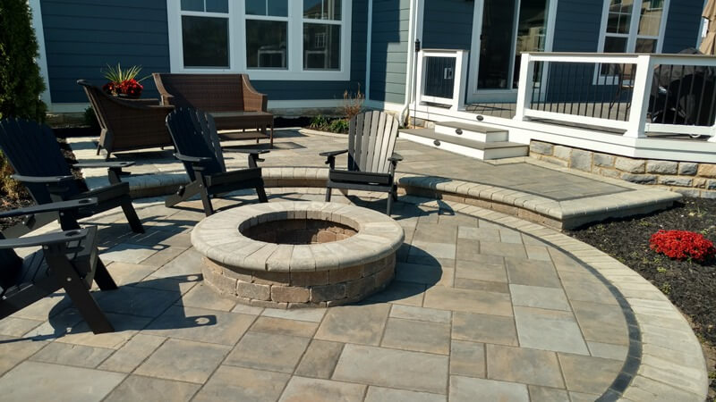 Custom backyard deck and patio with fire pit