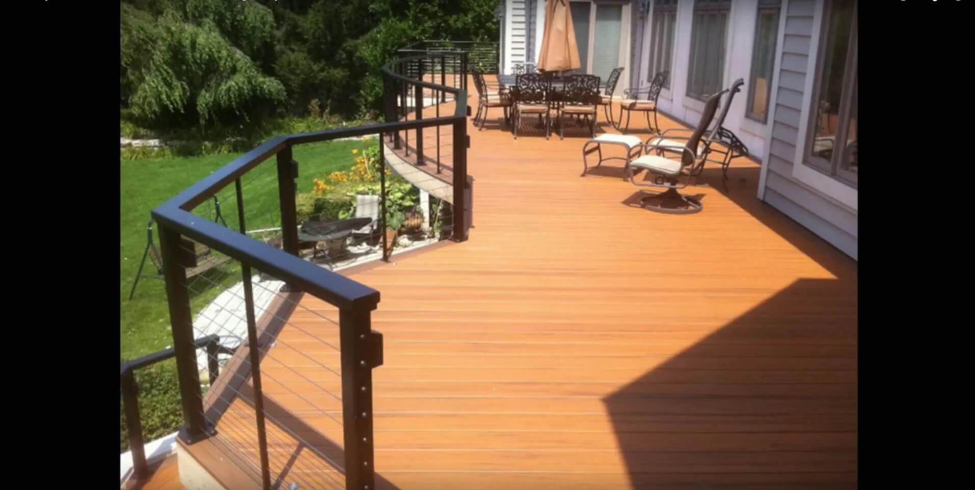 Custom backyard deck with seating area and railing