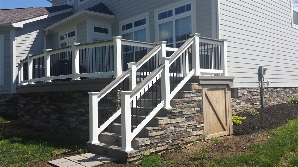 Custom backyard deck with railing and staircase