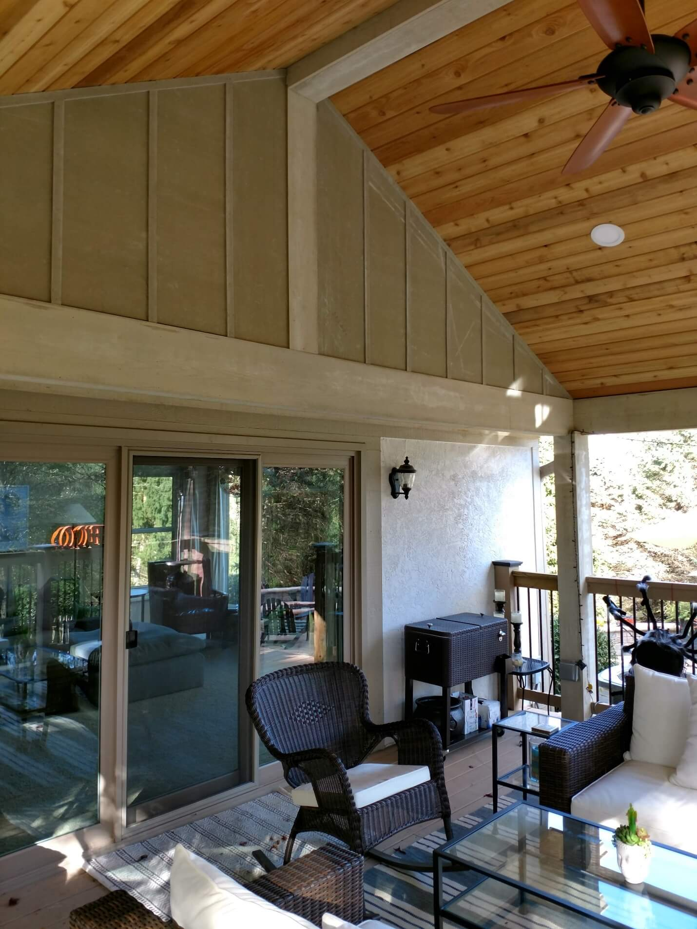 Covered porch seating area and sliding door