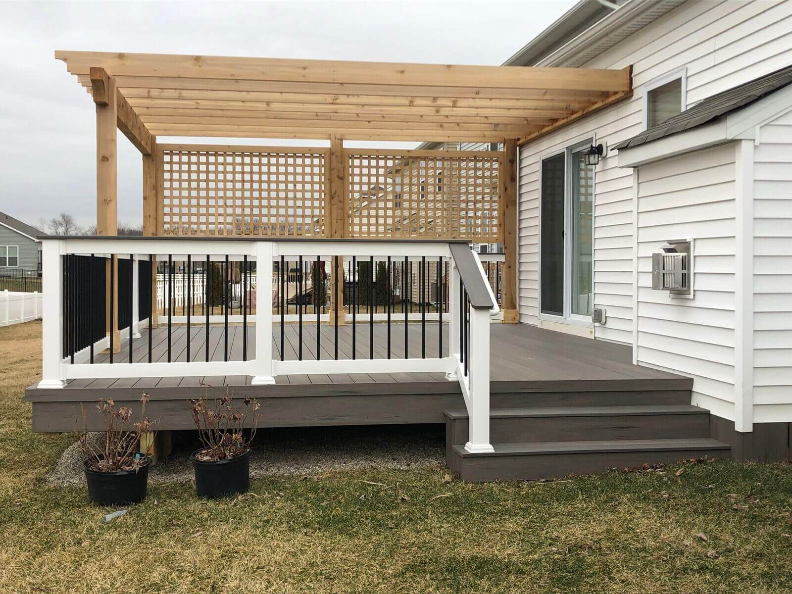 Custom backyard deck with pergola and privacy screen