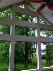 screened porch with lots of natural light