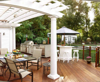 Custom backyard deck with pergola and outdoor kitchen