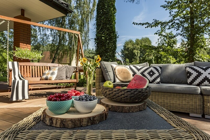 Cozy deck with assorted fruits on table