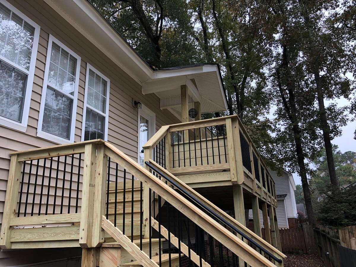 Porch expansion with custom railing