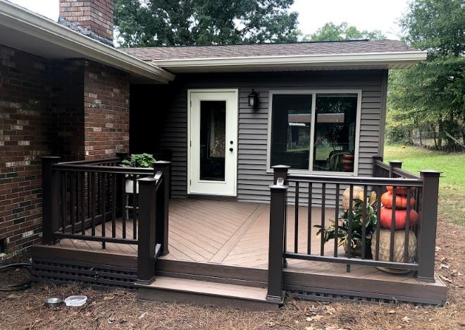 Sunroom and deck with railing and plant decors