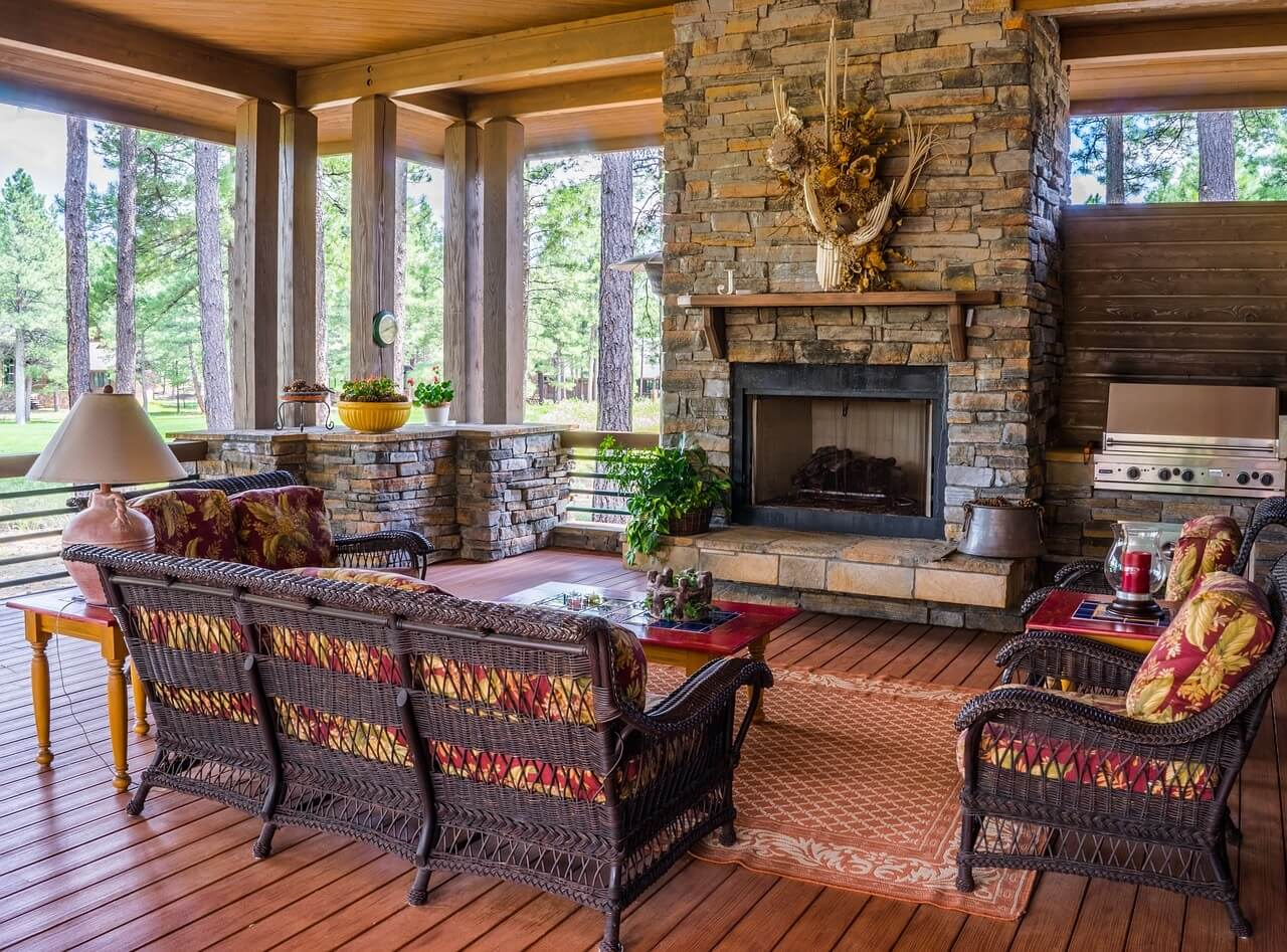 Rustic screened porch with outdoor fireplace