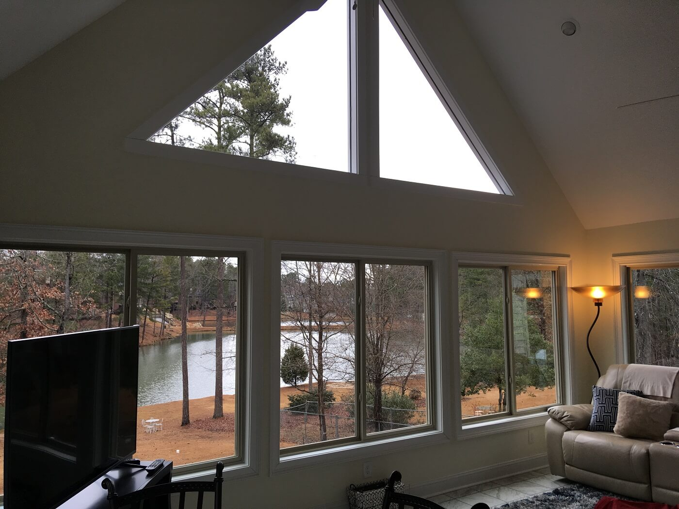 Interior of sunroom with private pond view