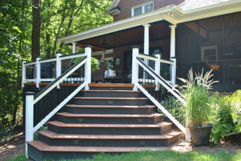 A grand entrance from the backyard onto this deck and covered porch combo in Governors Grant Lexington SC