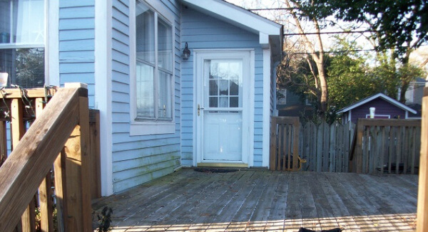 Before: this image shows the existing deck before we converted a portion into a lovely screened porch.