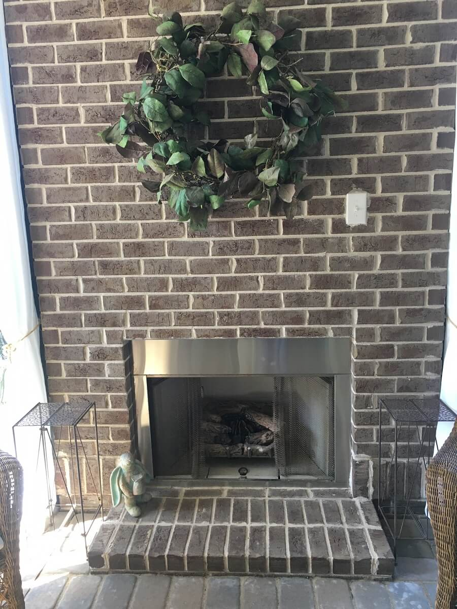 Custom fireplace on screened porch