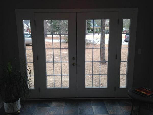 View into landscape through Columbia SC entry sunroom