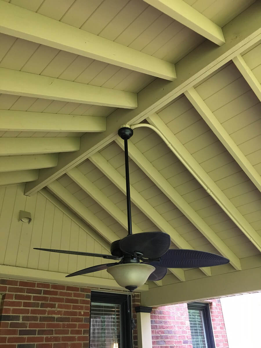 Porch wood ceiling with fan