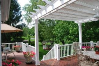 Large deck with with white vinyl pergola