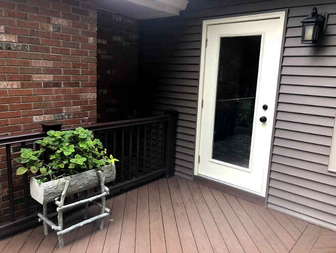 Sunroom and deck with planter box
