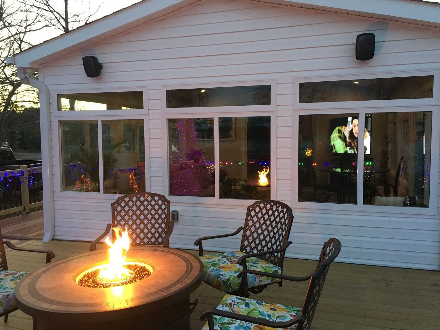 Sunroom and deck with fire pit