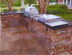 This multi-functional outdoor kitchen features