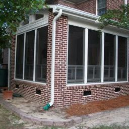 This vinyl fourtrack aluminum three season room with brick exterior blends seamlessly with home in Columbia. SC