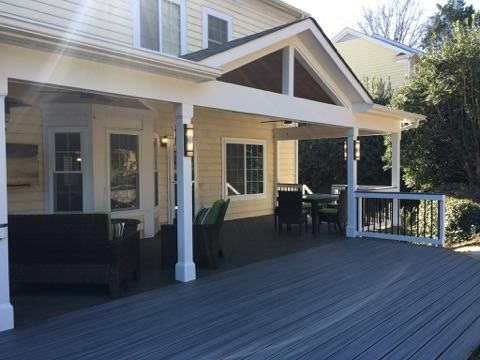 covered porch with an extended deck