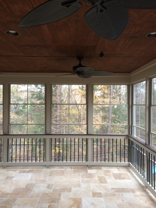 screened in porch with floor to ceiling windows