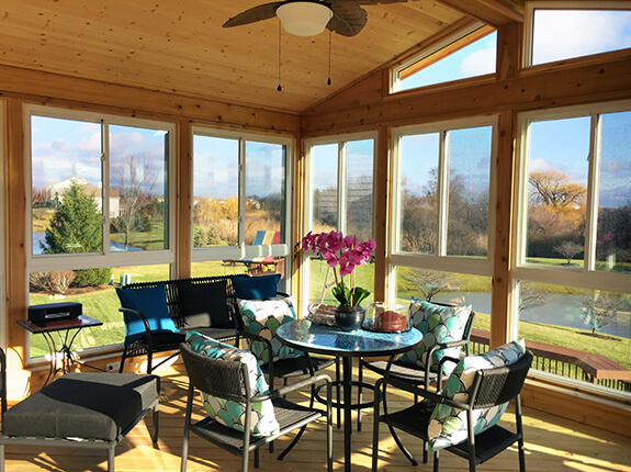 sunroom with wooden interior and furniture