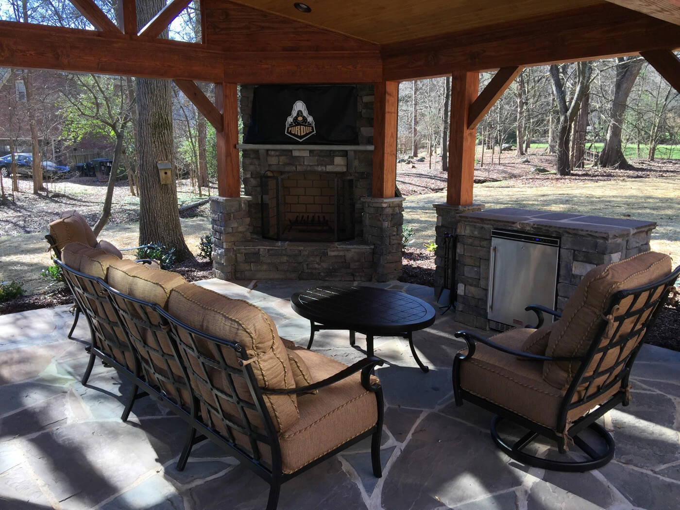 covered porch with built in fireplace and barbecue