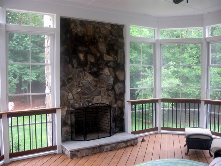 Eze-Breeze porch with built in fireplace