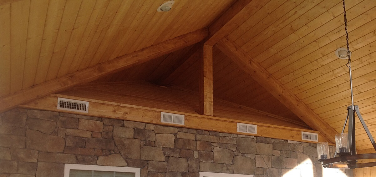 exposed wooden ceiling on a porch