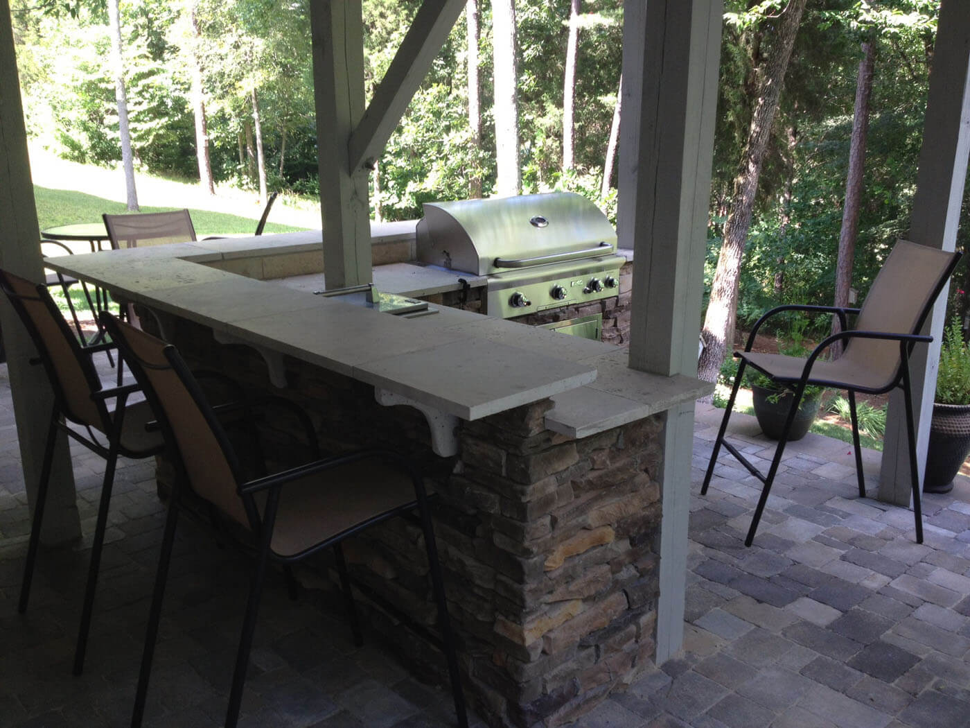paver patio with outdoor kitchen