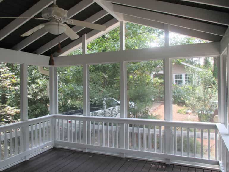 enclosed porch with high ceiling and large windows