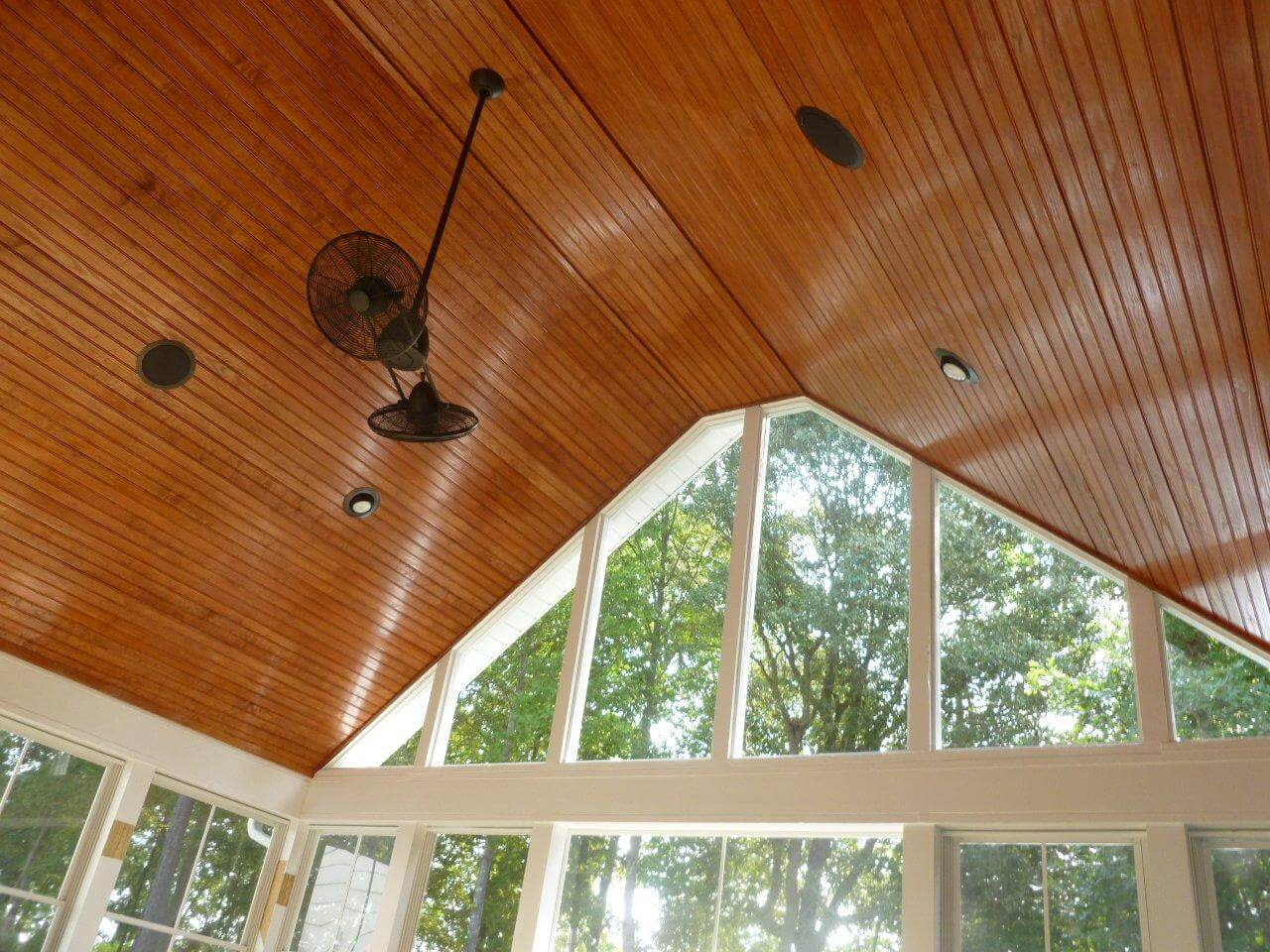 vaulted ceiling on a porch with a ceiling fan