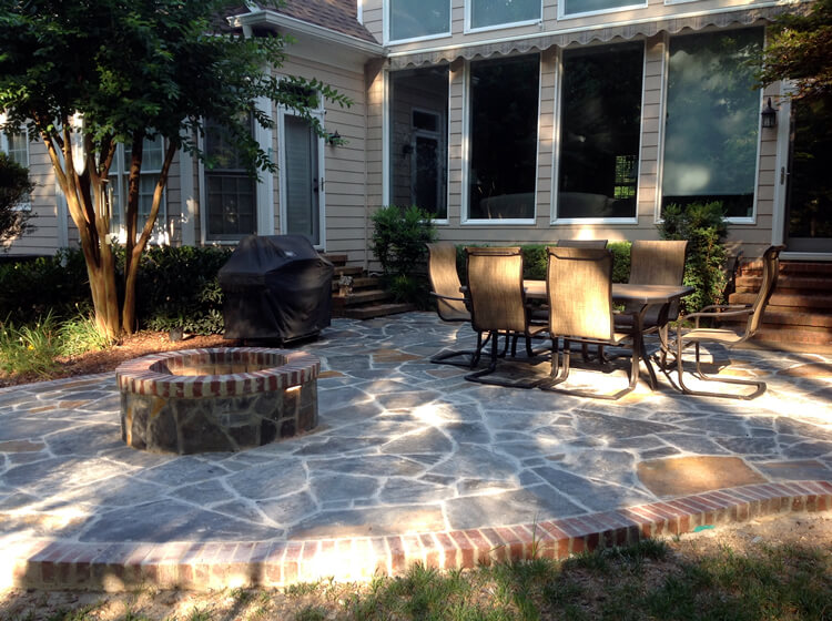 Myers Park fire pit on a patio with outdoor furniture and barbecue