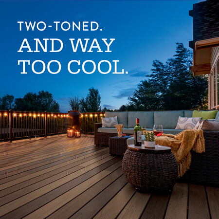 TimberTech dual tone deck at night with lights, text says - Two-Toned. And Way Too Cool.