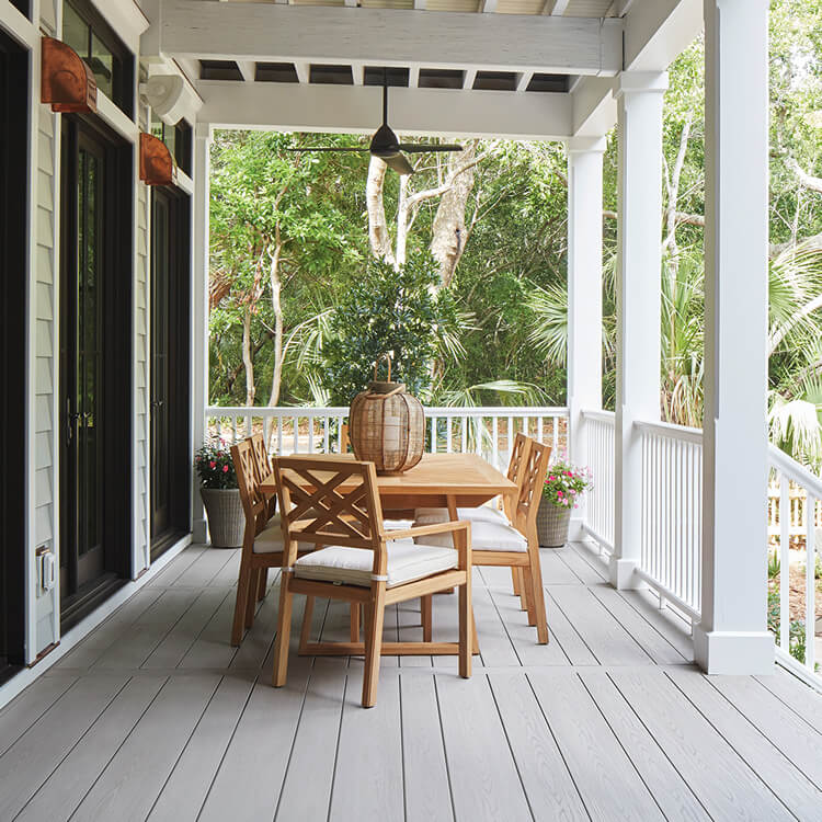 TimberTech porch with white railing and details and wood table