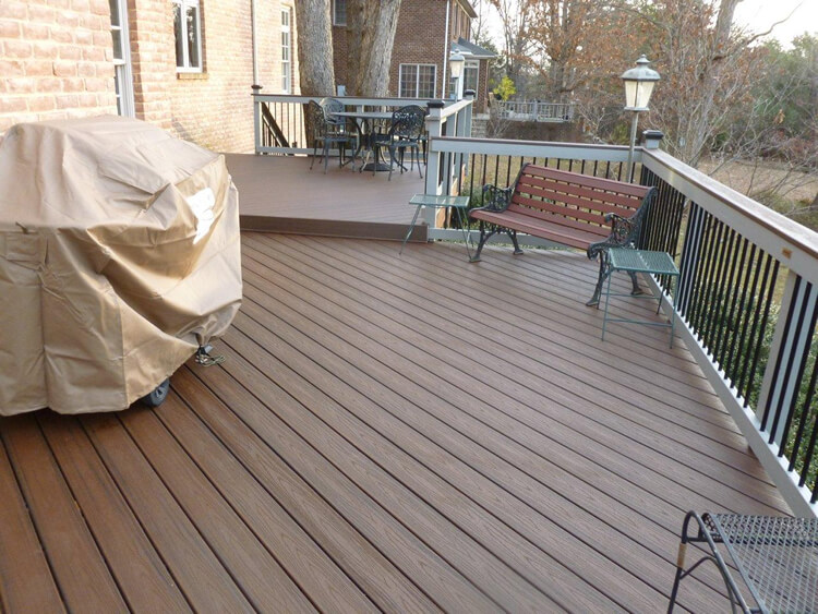 deck with covered barbecue and outdoor furniture