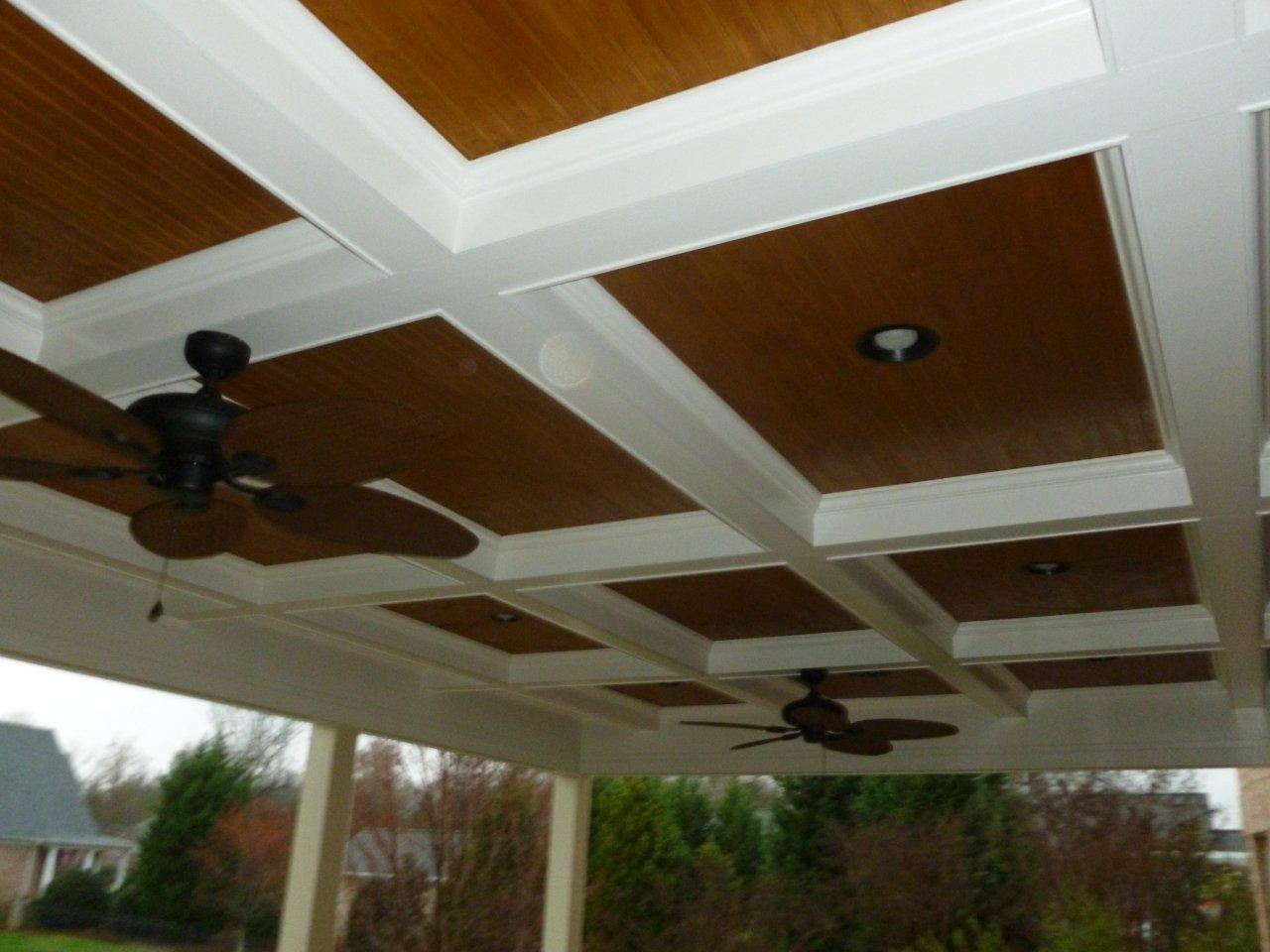 porch with a flat paneled ceiling with ceiling fans