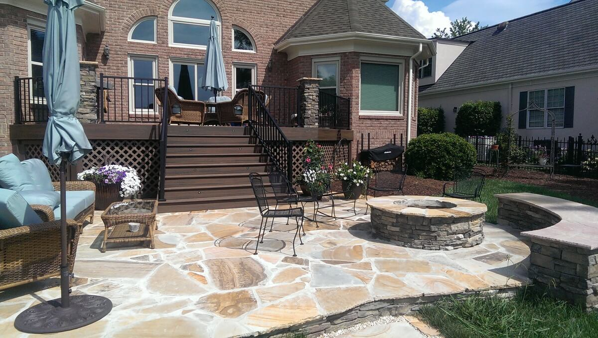 Charlotte Flagstone Patio With Fire Pit And Bench Retaining Wall 1)