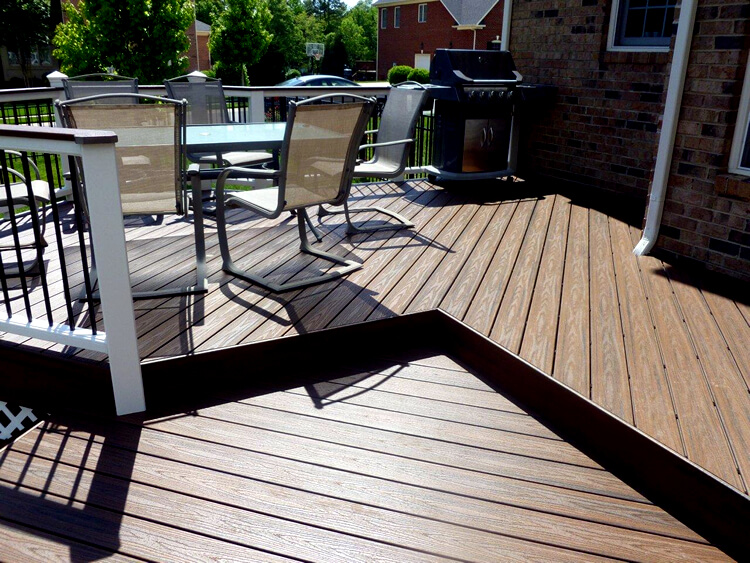 Custom multi-level deck with dining area and outdoor kitchen