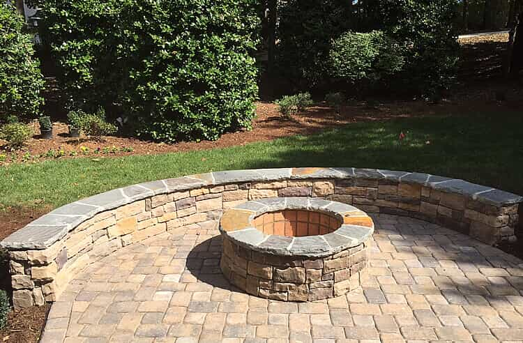 stone patio with seating wall and fire pit