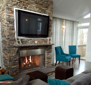 gas burning fireplace with TV above