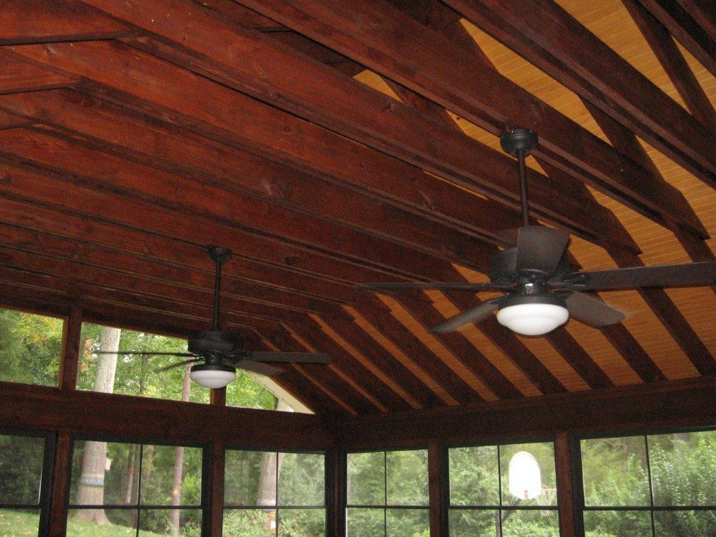 screened in porch with high, exposed ceiling